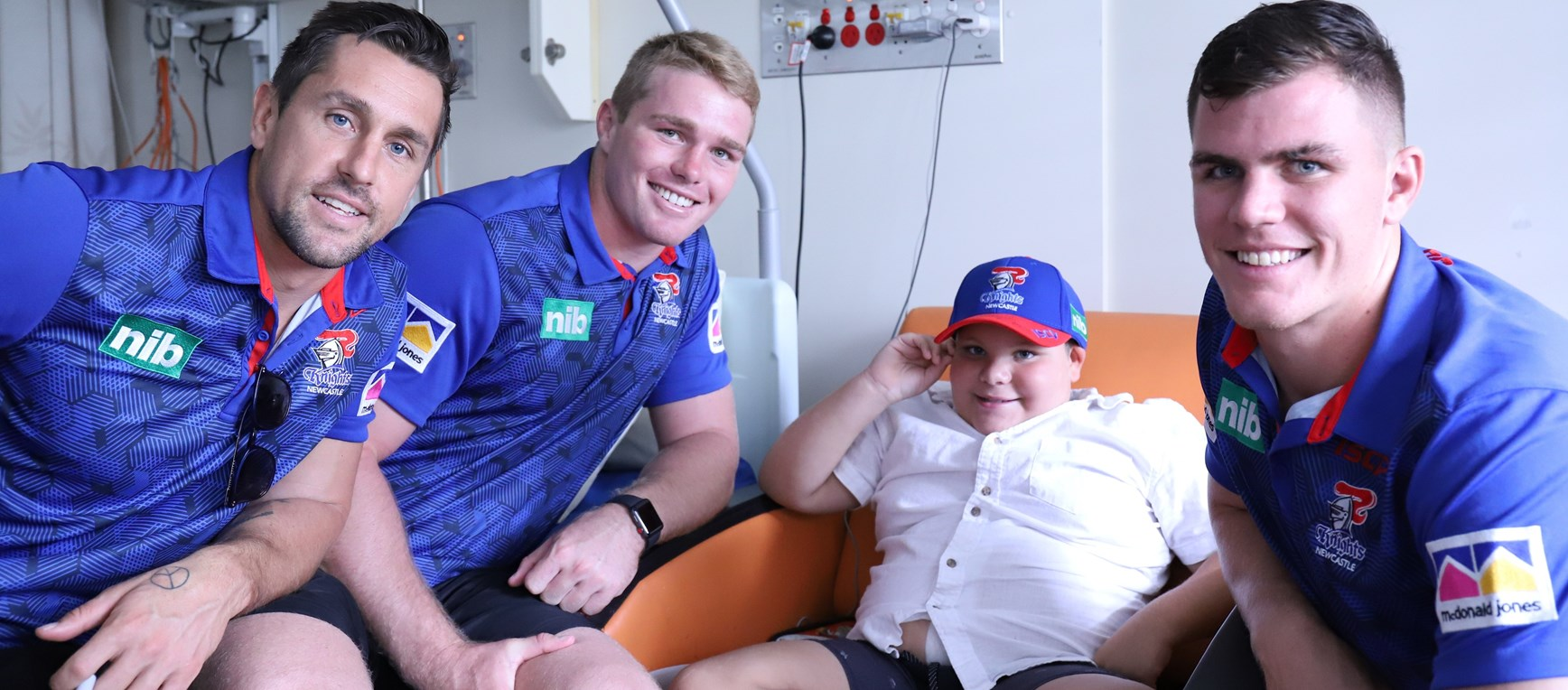 Smiles all round as Knights visit Children's hospital