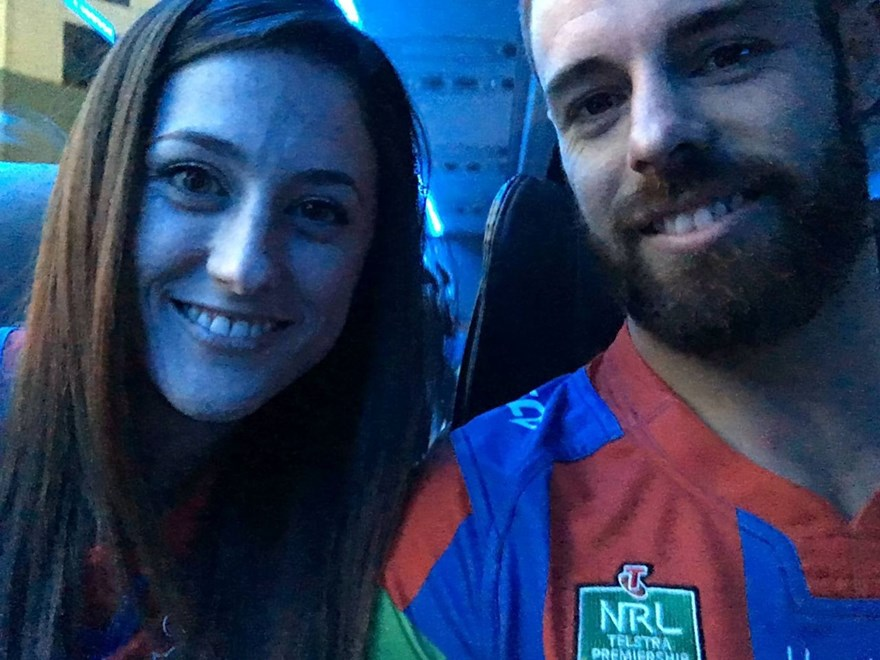 Lucky winners Ami and Aaron on the Newcastle Knights' team bus.